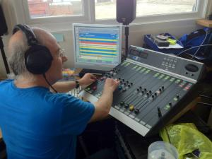 Patrick Woodward operating the desk at Jubilee FM, Worthing